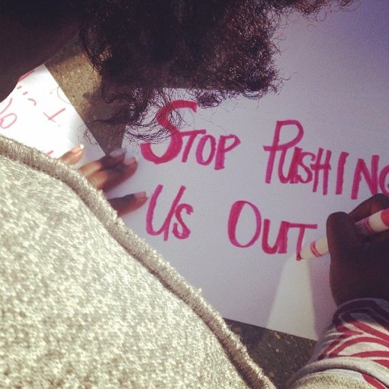 Sign-making before we protested at a 7-11 Committee meeting.