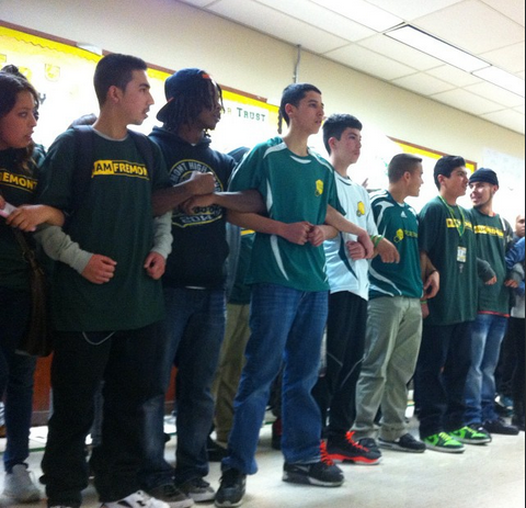 """OUSD Admin tried to tell the students to go off into another room while they were disrupting the """"community engagement"""" meeting.  Instead, the students linked arms and blocked the entrance to the side room, and then took over the stage."""